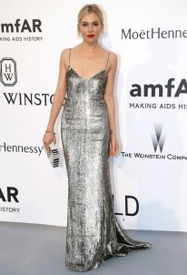 Sienna Miller poses for photographers upon arrival for the amfAR Cinema Against AIDS benefit at the Hotel du Cap-Eden-Roc, during the 68th Cannes international film festival, Cap d'Antibes, southern France, Thursday, May 21, 2015. (AP Photo/Thibault Camus)